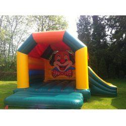 Château gonflable clown avec toboggan en location